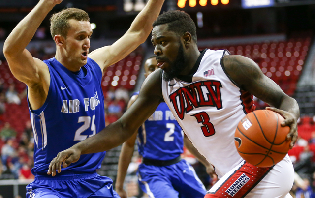 UNLV Rebels guard Jordan Cornish (3) drives against Air Force Falcons forward Kyle Broekhuis (25) during the Mountain West Conference basketball tournament at the Thomas & Mack Center in Las V ...
