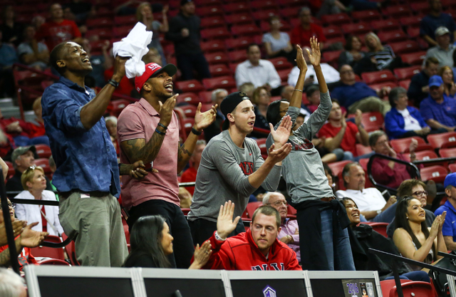 UNLV fans react as the team plays Air Force during the Mountain West Conference basketball tournament at the Thomas & Mack Center in Las Vegas on Wednesday, March 9, 2016. UNLV won 108-102 in  ...