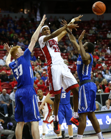 UNLV Rebels guard Patrick McCaw (22) makes a pass between Air Force Falcons center Frank Toohey (33) and Air Force Falcons guard CJ Siples (2) during the Mountain West Conference basketball tourna ...