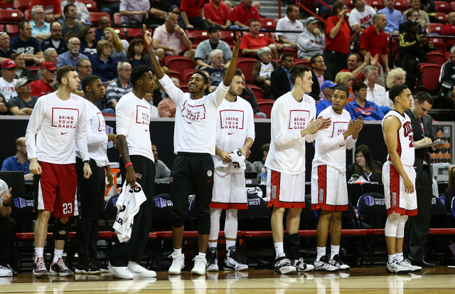 UNLV's Derrick Jones, fourth from left, motions to the crowd as the team plays Air Force during the Mountain West Conference basketball tournament at the Thomas & Mack Center in Las Vegas on W ...