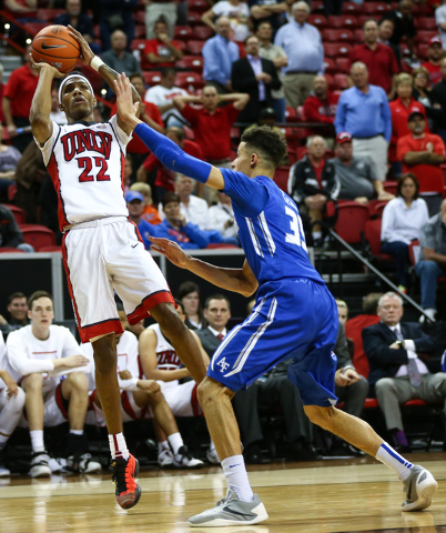 UNLV Rebels guard Patrick McCaw (22) shoots over Air Force Falcons forward Hayden Graham (35) during the Mountain West Conference basketball tournament at the Thomas & Mack Center in Las Vegas ...