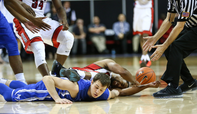 UNLV Rebels guard Jerome Seagears (2) falls on top of Air Force Falcons guard Daniel Hummer (4), who fouled Seagers, during the Mountain West Conference basketball tournament at the Thomas & M ...