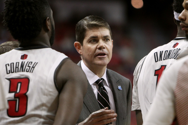 UNLV head coach Dave Rice talks to his players during the second half of their Mountain West Conference game against Fresno State Tuesday, Feb. 10, 2015, at the Thomas & Mack Center. UNLV won  ...