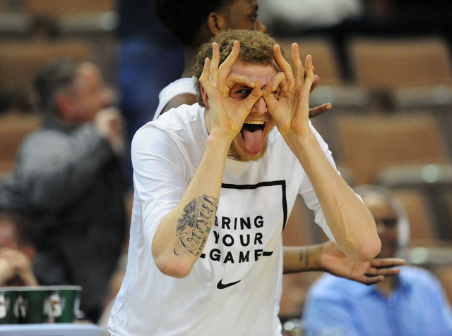 Oakland center Brad Brechting reacts after the Golden Grizzlies made a three-point shot against ETSU in the second half of their NCAA college basketball game at Mandalay Bay Events Center in Las V ...