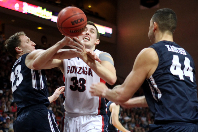 Gonzaga forward Kyle Wiltjer is fouled by BYU guard Skyler Halford during the second half of their West Coast Conference championship game Tuesday, March 10, 2015, at the Orleans Arena. Gonzaga wo ...