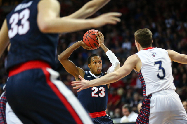 Gonzaga guard Eric McClellan (23) looks for an open pass as Saint Mary's guard Emmett Naar (3) defends during the West Coast Conference basketball championship game at the Orleans Arena in Las Veg ...