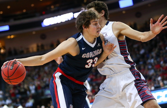 Gonzaga forward Kyle Wiltjer (33) pushes up against Saint Mary's center Evan Fitzner (21) during the West Coast Conference basketball championship game at the Orleans Arena in Las Vegas on Tuesday ...