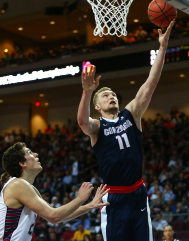 Gonzaga forward Domantas Sabonis (11) goes up to the net over Saint Mary's center Evan Fitzner (21) during the West Coast Conference basketball championship game at the Orleans Arena in Las Vegas  ...