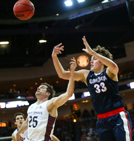 Gonzaga forward Kyle Wiltjer (33) loses control of a pass as Saint Mary's guard Joe Rahon (25) defends during the West Coast Conference basketball championship game at the Orleans Arena in Las Veg ...