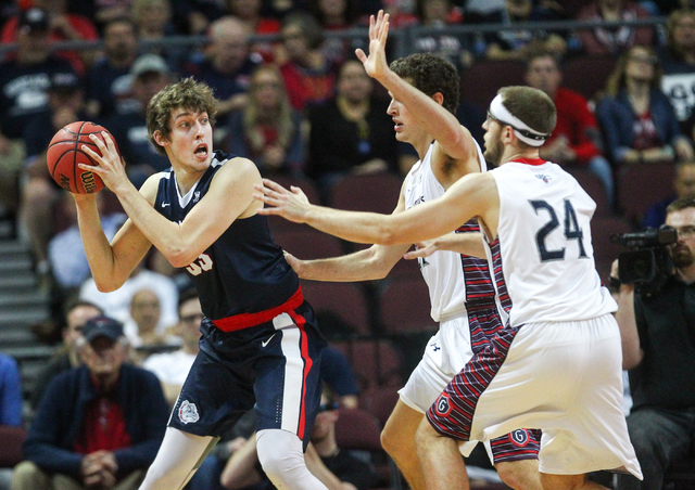 Gonzaga forward Kyle Wiltjer (33) is defended by Saint Mary's center Evan Fitzner (21) and Saint Mary's forward Calvin Hermanson (24) during the West Coast Conference basketball championship game  ...