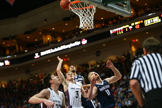 Saint Mary's guard Emmett Naar (3) sends up a shot as teammate Dane Pineau (22) looks on while Gonzaga's Josh Perkins (13) Domantas Sabonis (11) defend during the West Coast Conference basketball  ...