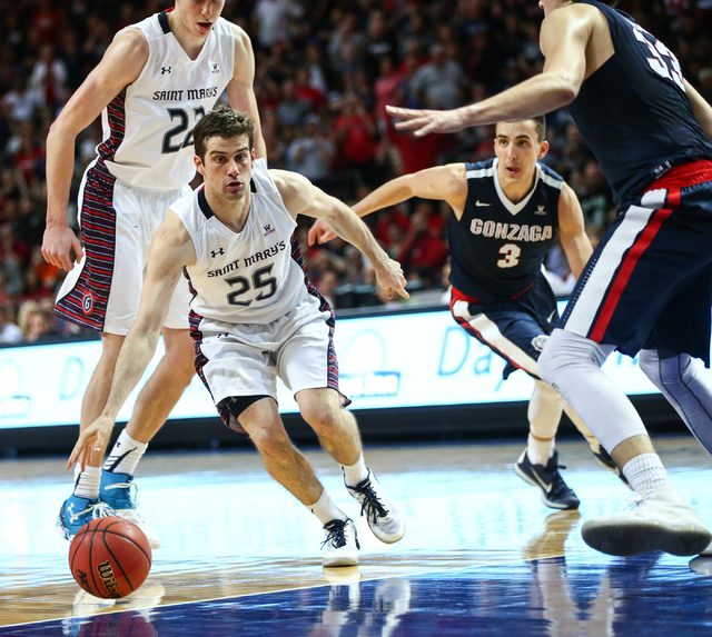 Saint Mary's guard Joe Rahon (25) gets past Gonzaga guard Kyle Dranginis (3) during the West Coast Conference basketball championship game at the Orleans Arena in Las Vegas on Tuesday, March 8, 20 ...