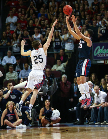 Gonzaga guard Josh Perkins (13) goes up for a shot over Saint Mary's guard Joe Rahon (25) during the West Coast Conference basketball championship game at the Orleans Arena in Las Vegas on Tuesday ...