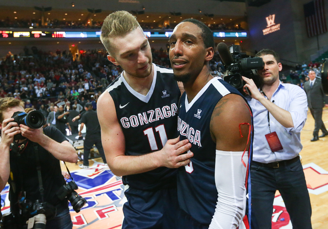 Gonzaga forward Domantas Sabonis (11) and guard Eric McClellan (23) react after their 85-75 win over Saint Mary's in the West Coast Conference basketball championship game at the Orleans Arena in  ...