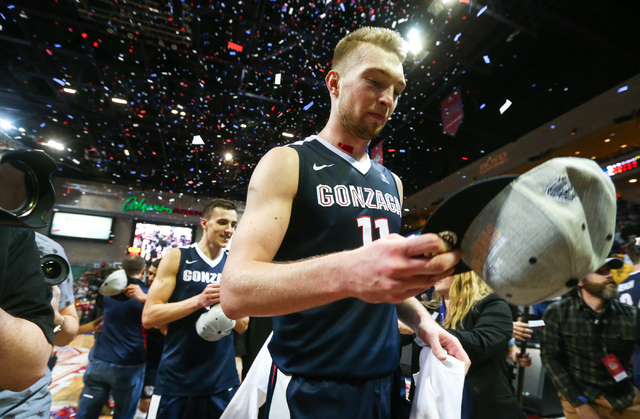 Gonzaga forward Domantas Sabonis (11) grabs a hat while celebrating his team's 85-75 win over Saint Mary's in the West Coast Conference basketball championship game at the Orleans Arena in Las Veg ...