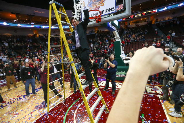 Gonzaga head coach Mark Few holds the net following his team's 85-75 win over Saint Mary's in the West Coast Conference basketball championship game at the Orleans Arena in Las Vegas on Tuesday, M ...