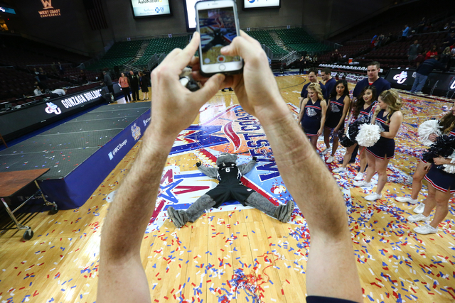 Members of the Gonzaga cheer team, including mascot Spike the Bulldog, celebrate their team's 85-75 win over Saint Mary's in the West Coast Conference basketball championship game at the Orleans A ...