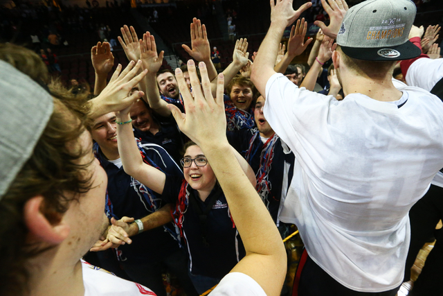 Gonzaga players celebrate with band members following their team's 85-75 win over Saint Mary's in the West Coast Conference basketball championship game at the Orleans Arena in Las Vegas on Tuesda ...
