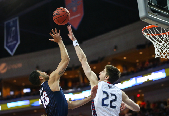 Gonzaga guard Josh Perkins (13) shoots over Saint Mary's forward Dane Pineau (22) during the West Coast Conference basketball championship game at the Orleans Arena in Las Vegas on Tuesday, March  ...