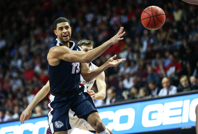 Gonzaga guard Josh Perkins (13) makes a pass while playing Saint Mary's during the West Coast Conference basketball championship game at the Orleans Arena in Las Vegas on Tuesday, March 8, 2016. G ...