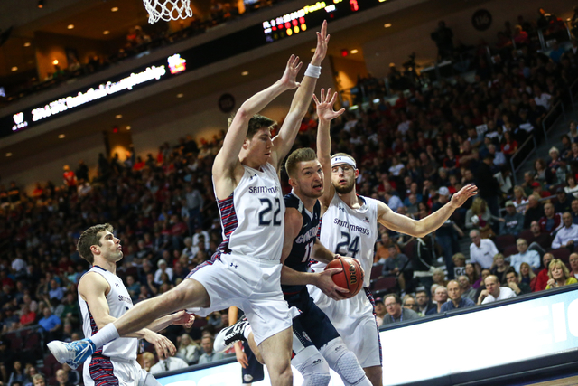 Gonzaga forward Domantas Sabonis (11) looks to get in a shot between Saint Mary's forwards Dane Pineau (22) and Calvin Hermanson (24) during the West Coast Conference basketball championship game  ...