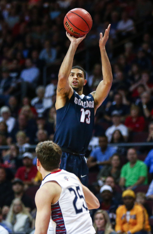 Gonzaga guard Josh Perkins (13) shoots a 3-pointer over Saint Mary's guard Joe Rahon (25) during the West Coast Conference basketball championship game at the Orleans Arena in Las Vegas on Tuesday ...