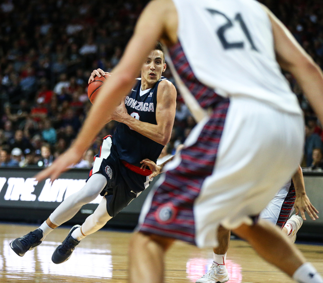Gonzaga guard Kyle Dranginis (3) drives as Saint Mary's center Evan Fitzner (21) looks to defend during the West Coast Conference basketball championship game at the Orleans Arena in Las Vegas on  ...