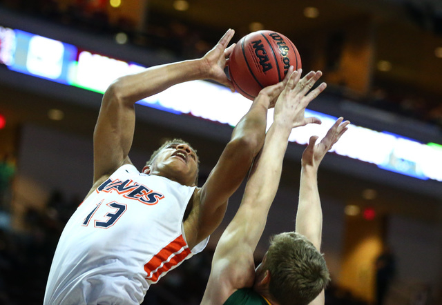 Pepperdine forward Kameron Edwards (13) shoots over San Francisco guard Tim Derksen (32) during the West Coast Conference basketball tournament quarterfinals at the Orleans Arena in Las Vegas on S ...