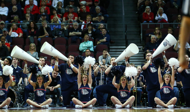 Gonzaga cheerleader and band members perform as the team plays Portland during the West Coast Conference basketball tournament quarterfinals at the Orleans Arena in Las Vegas on Saturday, March 5, ...