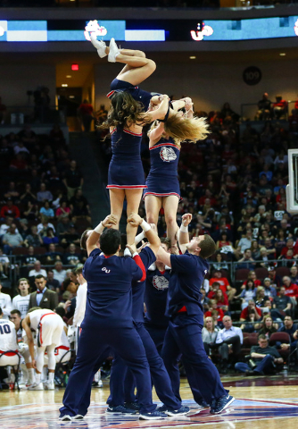 Gonzaga cheerleaders perform between a break as the team plays Portland during the West Coast Conference basketball tournament quarterfinals at the Orleans Arena in Las Vegas on Saturday, March 5, ...