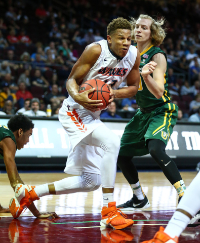 Pepperdine forward Kameron Edwards (13) drives against San Francisco guard Sean Grennan (30) during the West Coast Conference basketball tournament quarterfinals at the Orleans Arena in Las Vegas  ...