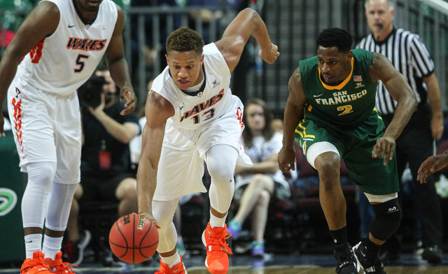 Pepperdine forward Kameron Edwards (13) brings the ball up court against San Francisco during the West Coast Conference basketball tournament quarterfinals at the Orleans Arena in Las Vegas on Sat ...
