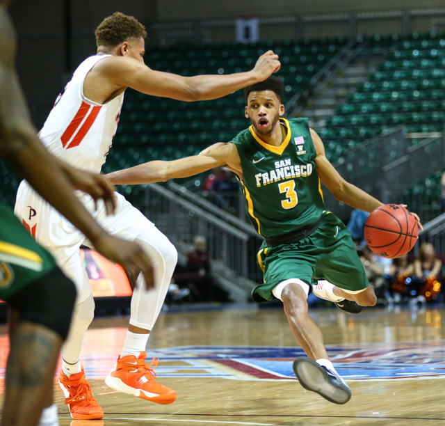 San Francisco guard Ronnie Boyce III (3) drives against Pepperdine during a West Coast Conference basketball tournament quarterfinals at the Orleans Arena in Las Vegas on Saturday, March 5, 2016.  ...