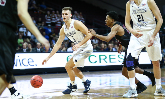 Brigham Young guard Kyle Collinsworth (5) brings the ball up court against Santa Clara during the West Coast Conference basketball tournament quarterfinals at the Orleans Arena in Las Vegas on Sat ...