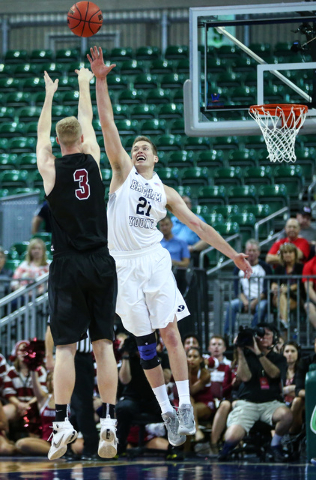 Santa Clara forward Henrik Jadersten (3) goes for a three-pointer as Brigham Young forward Kyle Davis (21) defends during the West Coast Conference basketball tournament quarterfinals at the Orlea ...