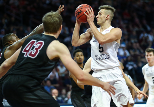 Brigham Young guard Kyle Collinsworth (5) looks for an open pass while playing Santa Clara during the West Coast Conference basketball tournament quarterfinals at the Orleans Arena in Las Vegas on ...