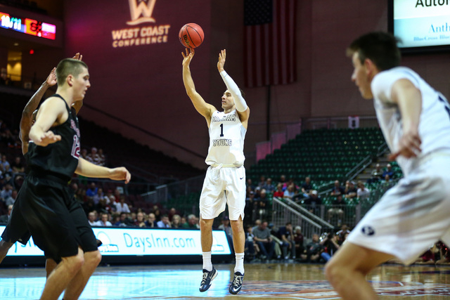 Brigham Young guard Chase Fischer (1) goes up to score a three-pointer against Santa Clara during the West Coast Conference basketball tournament quarterfinals at the Orleans Arena in Las Vegas on ...