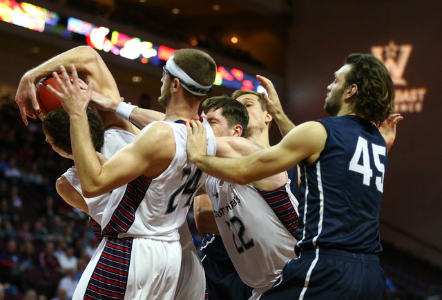 Saint Mary's and Loyola Marymount players get tangled up while fighting for the ball during the West Coast Conference basketball tournament quarterfinals at the Orleans Arena in Las Vegas on Satur ...