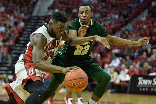 UNLV Rebels guard Ike Nwamu (34) drives the ball to the basket past Colorado State Rams guard Jeremiah Paige (22) during a game against Colorado State at the Thomas & Mack Center in Las Vegas  ...