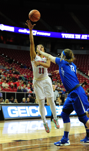 UNLV guard Dylan Gonzalez (11) goes up for a shot against Air Force forward Sarah Fotsch in the first half of their NCAA basketball game at the Thomas & Mack Center in Las Vegas Monday, March  ...
