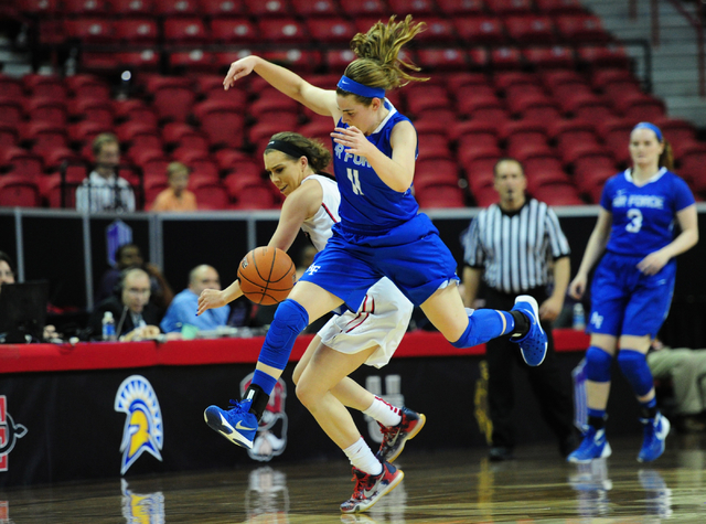 Air Force guard Courtney Porter (11) and UNLV Rebels guard Brooke Johnson (2) chase after a loose ball in the third quarter of their NCAA basketball game at the Thomas & Mack Center in Las Veg ...
