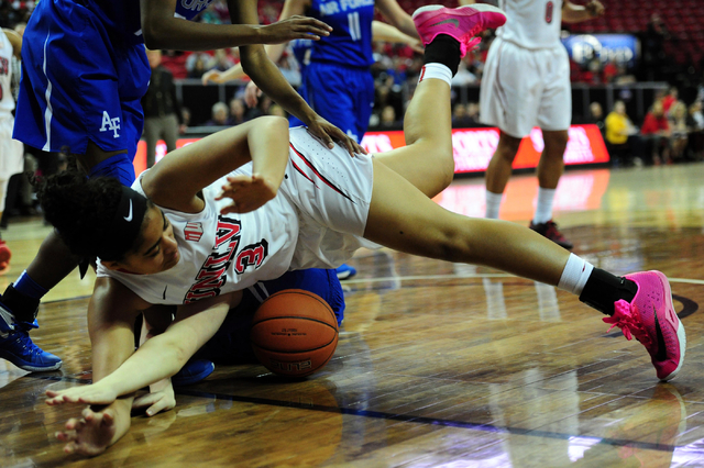 UNLV forward Paris Strawther (3) and Air Force guard Cheyenne Wall fall on a loose ball in the second quarter of their NCAA basketball game at the Thomas & Mack Center in Las Vegas Monday, Mar ...