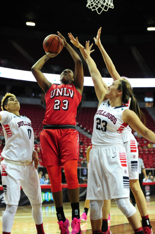 UNLV forward Jordyn Bell (23) goes up for a shot against Fresno forward Breanne Knishka (23) and guard Moriah Faulk (0) in the first quarter of their Mountain West Conference semifinal basketball  ...