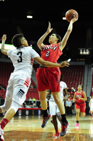 UNLV Rebels guard Brooke Johnson (2) goes up for a shot against Fresno guard Brittany Aikens (3) in the first quarter of their Mountain West Conference semifinal basketball game at the Thomas &amp ...