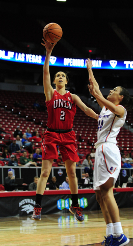 UNLV Rebels guard Brooke Johnson (2) goes up for a shot against Boise State guard Brooke Pahukoa in the first quarter of their Mountain West Conference quarterfinal basketball game at the Thomas & ...