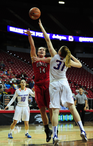 UNLV Rebels center Aley Rohde (14) goes up for a shot against Boise State guard Marijke Vanderschaaf (31) in the first quarter of their Mountain West Conference quarterfinal basketball game at the ...