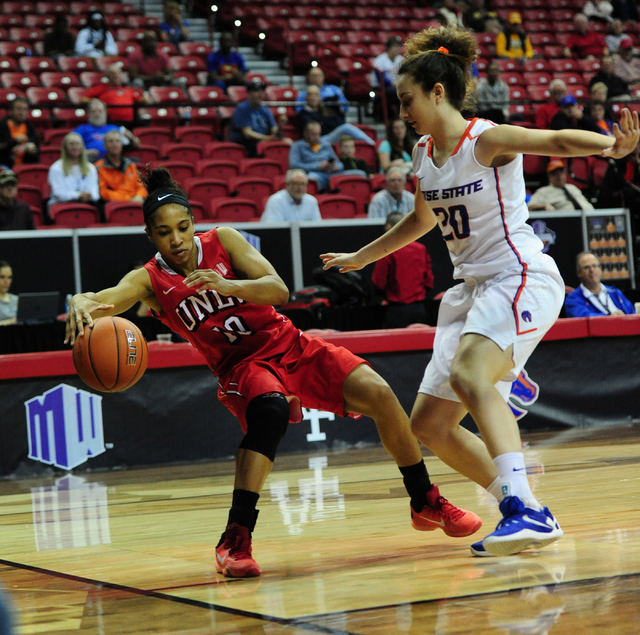 UNLV Rebels guard Nikki Wheatley (10) saves a ball from going out of bounds while Boise State guard Marta Hermida defends in the first quarter of their Mountain West Conference quarterfinal basket ...