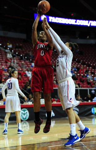 UNLV center Amie Callaway (0) goes up for a shot against Boise State forward Shay Shaw (2) during their Mountain West Conference quarterfinal basketball game at the Thomas & Mack Center in Las ...