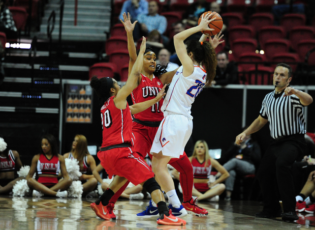 UNLV guards Nikki Wheatley (10) and UNLV Dylan Gonzalez (11) defend Boise State guard Marta Hermida in the second quarter of their Mountain West Conference quarterfinal basketball game at the Thom ...