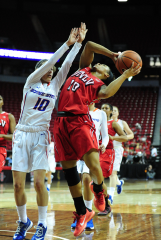 UNLV guard Nikki Wheatley (10) goes up for a shot against Boise State guard Yaiza Rodriguez in the second quarter of their Mountain West Conference quarterfinal basketball game at the Thomas & ...